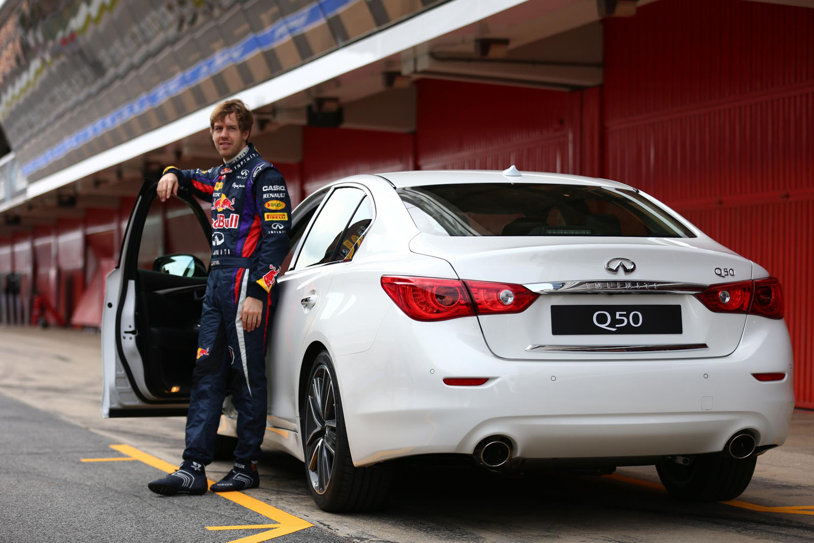 Sebastian Vettel with the Infiniti Q50